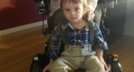 Transporting toddler on wheelchair footrest