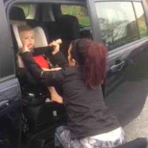 Photo of mother in wheelchair and son in carseat