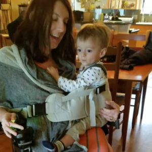 Mother in wheelchair using baby carrier