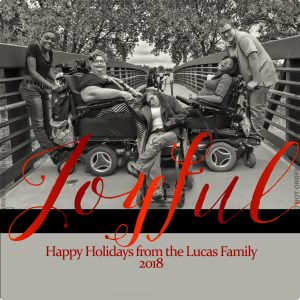 Christmas card showing woman in wheelchair and her four children.