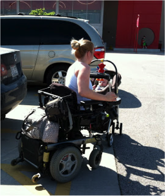 mother pushes baby in stroller while in wheelchair