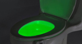 Picture of a toilet lit up in green